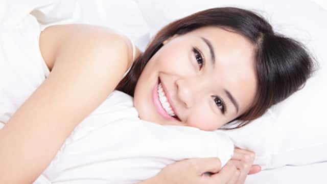 portrait of happiness woman smile lying on bed